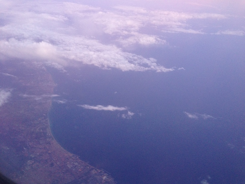 Flying over Spain. I'm pretty sure that's the Barcelona coast you can see